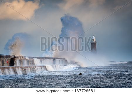 Big Wave hits Tynemouth Pier, as a stormy sea hits it, resulting in high crashing waves cascading into the mouth of the River Tyne