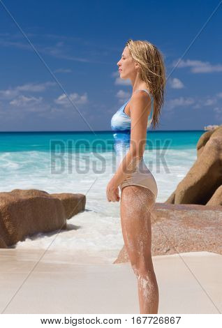 Beautiful and sexy blonde woman in horizon pattern swimsuit, beach