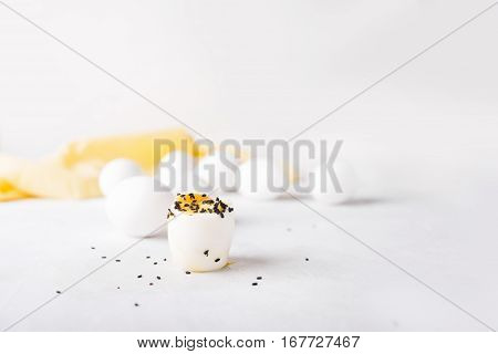 Boiled egg in a small cup on a white background. Eggs. Breakfast. Easter photo concept. Copyspace
