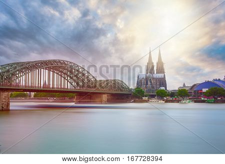 View on Cologne Cathedral and Hohenzollern Bridge, in the sunrise. Germany. Panorama of the city