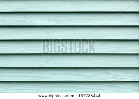 Turquoise wood planks. Kiln dried wooden lumber texture background. Painted pine furniture surface. Timber hardwood wall.