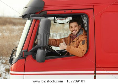 Young man driving big modern truck