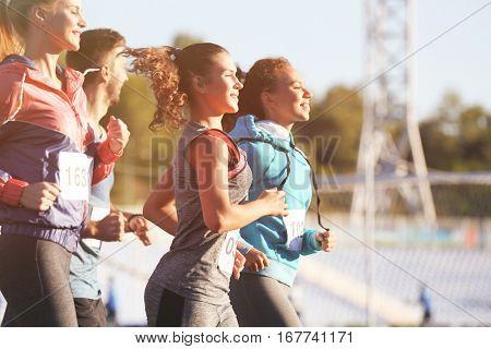Sportsmen running at stadium
