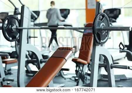 Barbell on rack in gym