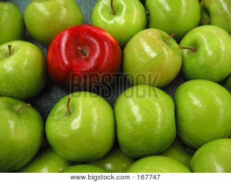 One Red Apple Among Green Ones