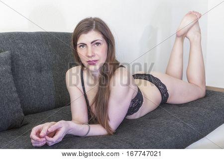 A pretty brunette young woman in underwear