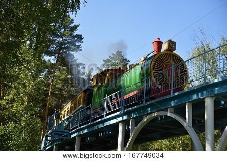 NOVOSIBIRSK, RUSSIA - SEPTEMBER 6, 2014: Train on the route to the zoo on the Childrens railway. Built in 2005 for about $9 millions, it is one of the best children's railroad in Russia