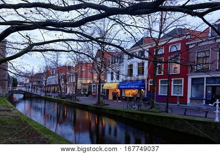 DELFT, NETHERLANDS - JANUARY 3, 2017: One of canals at Nieuwe Kerk. Delft is known for its historic town center with canals, Delft Blue pottery, and its association with the royal House of Orange