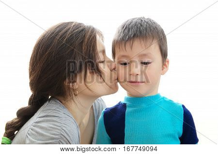 Mother kissing son isolated on white background trusting relationship concept boy smiling and happy child growth child care by parent