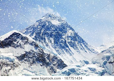 Mount Everest with snowfall. View of top of Mount Everest with clouds from Kala Patthar way to mount Everest base camp Everest area khumbu valley - Nepal poster