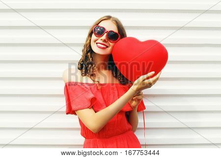 Pretty Smiling Woman In Red Dress And Sunglasses With Air Balloons Heart Shape Walking At City Over