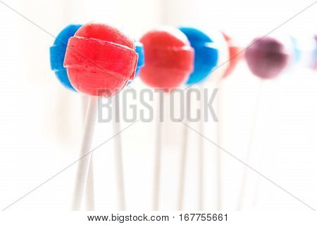 A row of lollipops of various colors