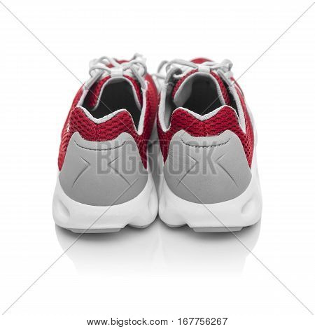 Unbranded modern sneakers isolated on a white background. Red sneakers. Back view.