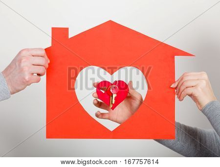 Hands Hold Little Heart With Keys And House.
