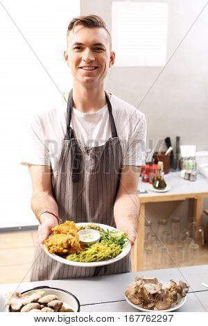 Vegetarian dish. Vegan dish. Smiling chef presents a ready dish
