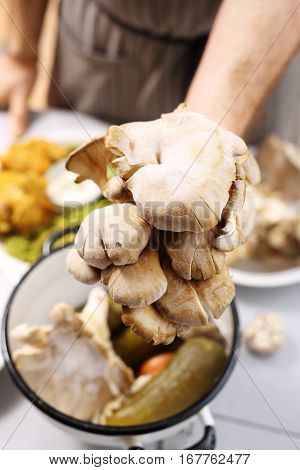 oyster mushrooms in the kitchen. Oyster dishes in the kitchen vegan. Oyster mushrooms, organic food.