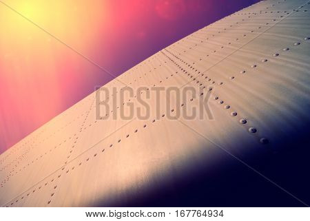 fragment of the old airplane fuselage against the sky