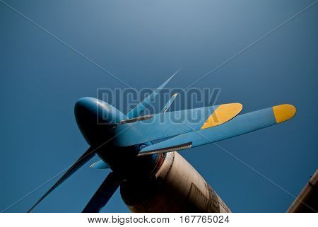 old propeller plane on a background of blue sky aircraft fragment