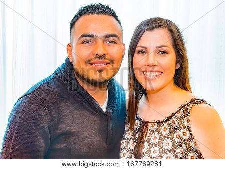 Beautiful Portrait of Happy Young Hispanic Couple