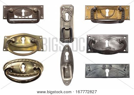 Display of vintage furniture hardware. Antique furniture metal handles.