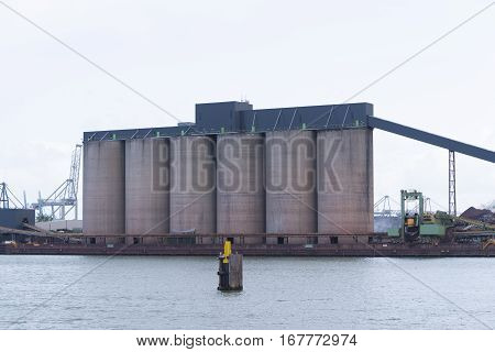 row of silos in the rotterdam bulk terminal the place for storage and transshipment of dry minerals including bauxite magnesite and bentonite.