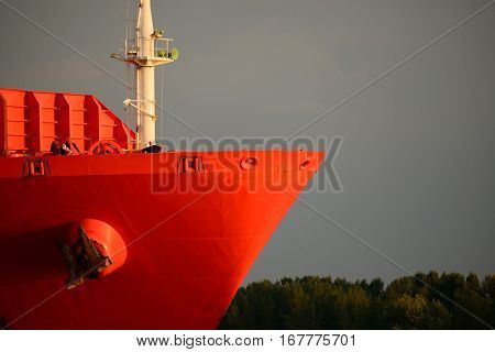 Red lean bow of a container ship on river Elbe Germany