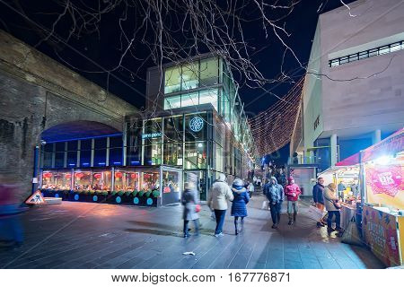 London, UK. 28th January 2017. People are walking towards the South Bank of the river Thames passing shops and restaurants
