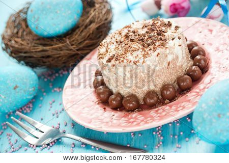 Easter dessert with cottage cheese and chocolate. Chocolate curd paskha with chocolate candy on holiday Easter table