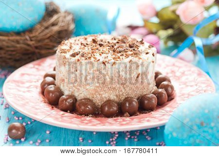 Traditional orthodox Easter dessert with cottage cheese and chocolate. Chocolate curd paskha with chocolate candy on holiday Easter table