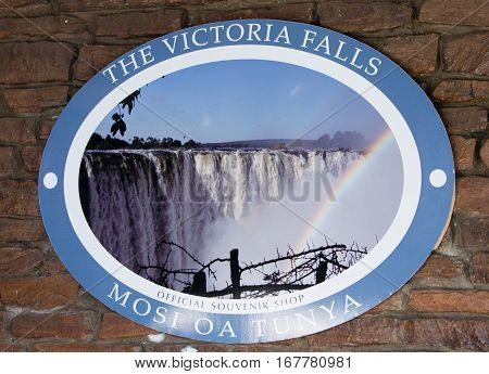 Entrance sign to The world famous Victoria Falls in Zimbabwe, also known as Mosi-oa-Tunya or The Smoke that Thunders which is a popular place for tourists to visit -  Zimbabwe, Southern Africa, October 2016