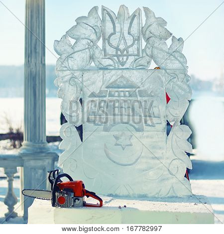 ice sculpture of ukraine emblem. Ternopil city coat of arms. Chain saw