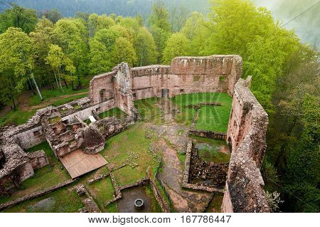 Aerial photograph from a drone of the ruins of the Chateau of Wangenbourg in the middle of the forest in Alsace commune of Wangenbourg-Engenthal in the Bas-Rhin departement of France.