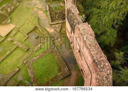 Aerial photograph from a drone of the wall ruins of the Chateau of Wangenbourg in the middle of the forest in Alsace commune of Wangenbourg-Engenthal in the Bas-Rhin departement of France.