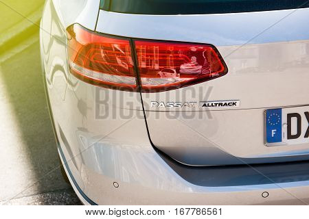 PARIS FRANCE - JUN 10 2016: Rear view of the insignia of a Volkswagen Pasat alltrack 4x4 estate vehicle. The Volkswagen emissions scandal (also known as
