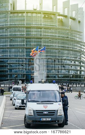 STRASBOURG FRANCE - OCT 7 2015: Police officers surveilling the main entrance of the European PArliament during the official visit of Francois Hollande French President to Strasbourg European Parliament and Council of Europe