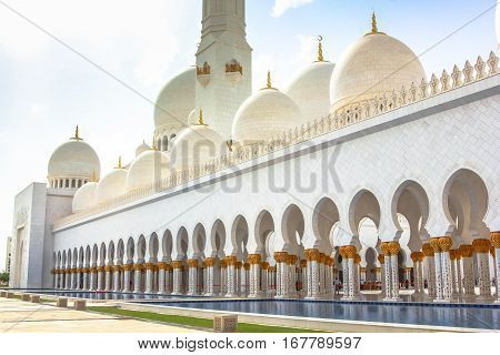 Pillars, arcades, domes and pool of Grand Mosque located in the heart of new Abu Dhabi between Musaffah Bridge and Maqta Bridge.Sheikh Zayed is the largest mosque in the United Arab Emirates.Side view