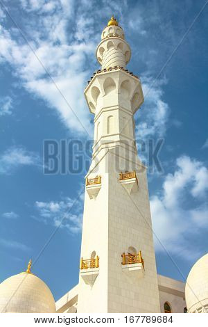 Closeup of minaret Grand Mosque Sheikh Zayed, Abu Dhabi, United Arab Emirates, the third largest mosque in the world. Islamic culture concept. Muslim religious icon.