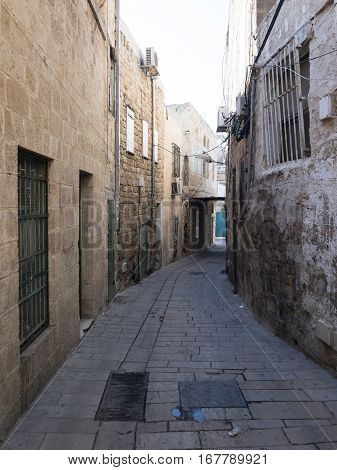 Narrow street in Akko or Acre, Israel