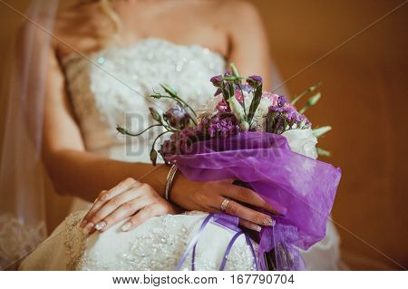 wedding bouquet orchids and peonies. Fine art wedding bouquet and flowers.