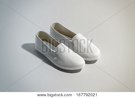 Blank white slip-on shoes pair design mockup isometric view 3d rendering. Plain hipster slipon mock up template stand. Urban skate shoes with clear label presentation.