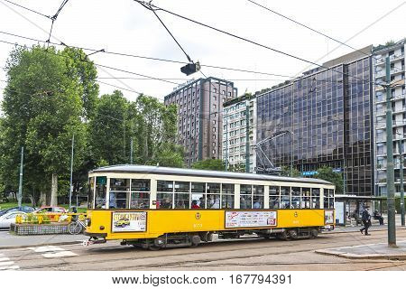 Vintage Yellow Tram On The Street In Of Milan, Italy