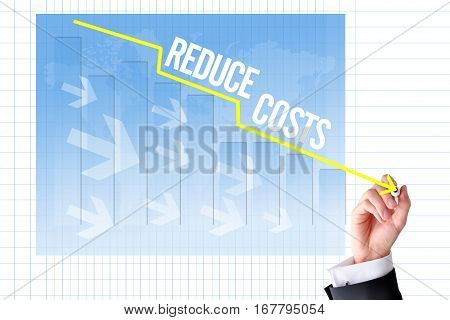 Reduce costs concept with businessman hand draw a graph