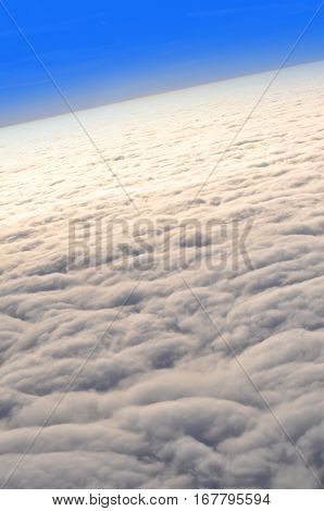 View above the clouds during a flight
