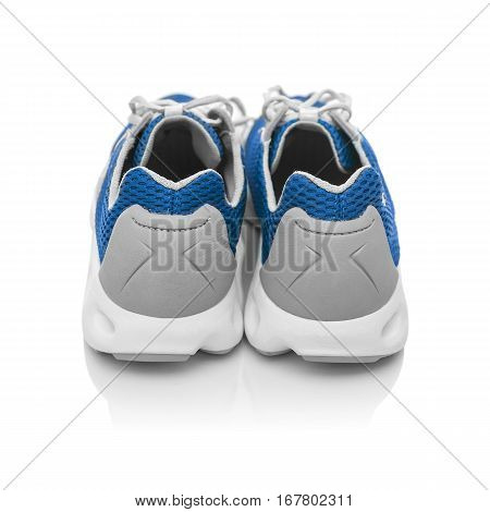 Unbranded modern sneakers isolated on a white background. Blue sneakers. Back view.