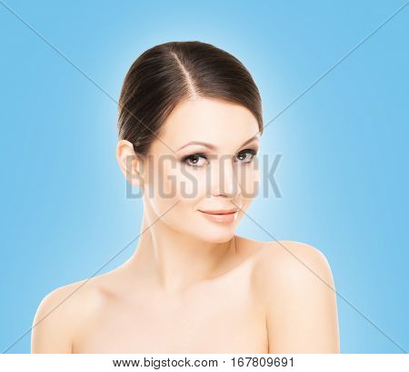 Beautiful face of young and attractive woman with smooth and healthy skin.