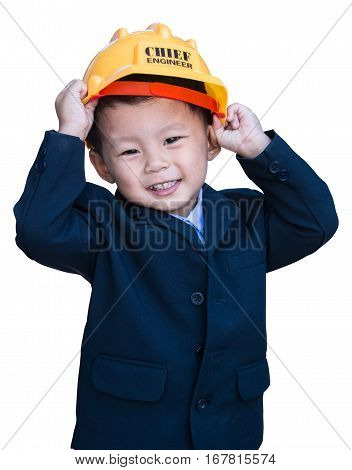 portrait of little boy in business suit and builder's helmet isolated on white background