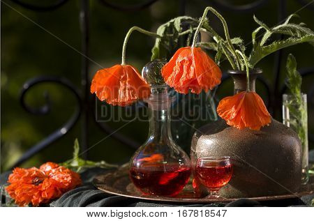red poppies and a decanter with liqueur
