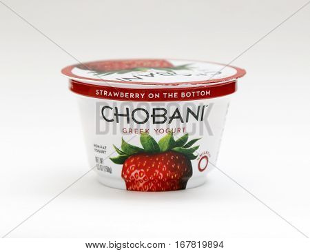 New York January 23 2017: A container of strawberry Chobani greek yogurt stands against white background.
