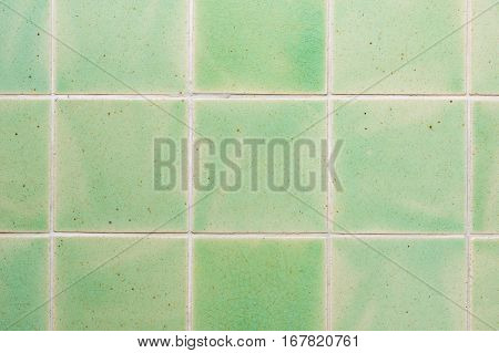 close up background and texture of stretch marks cracked on emerald green glazed tile