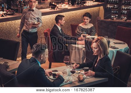 Elegant people enjoy the evening each other's company in a restaurant